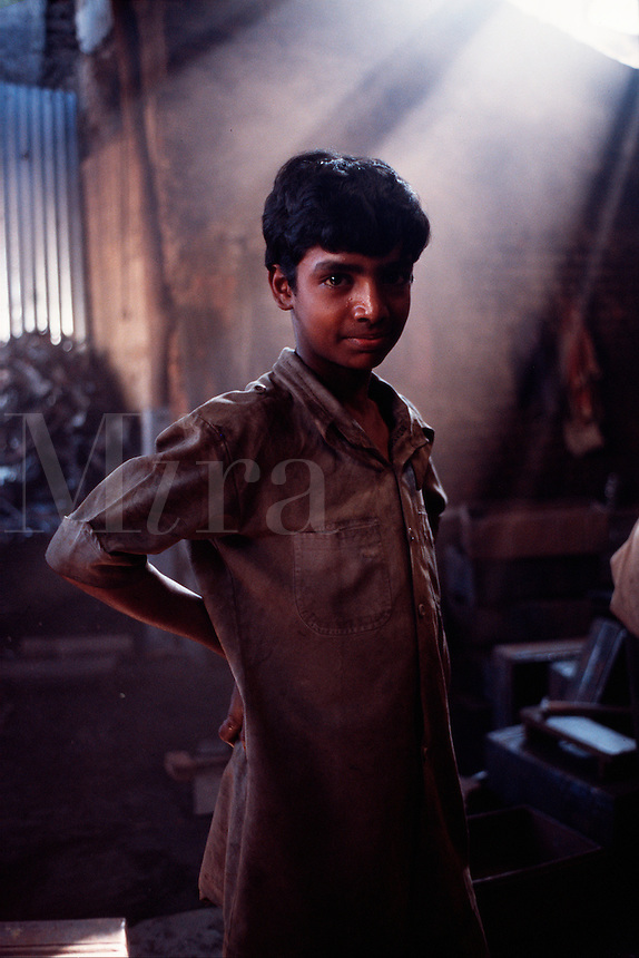 A young Indian boy at work. India.