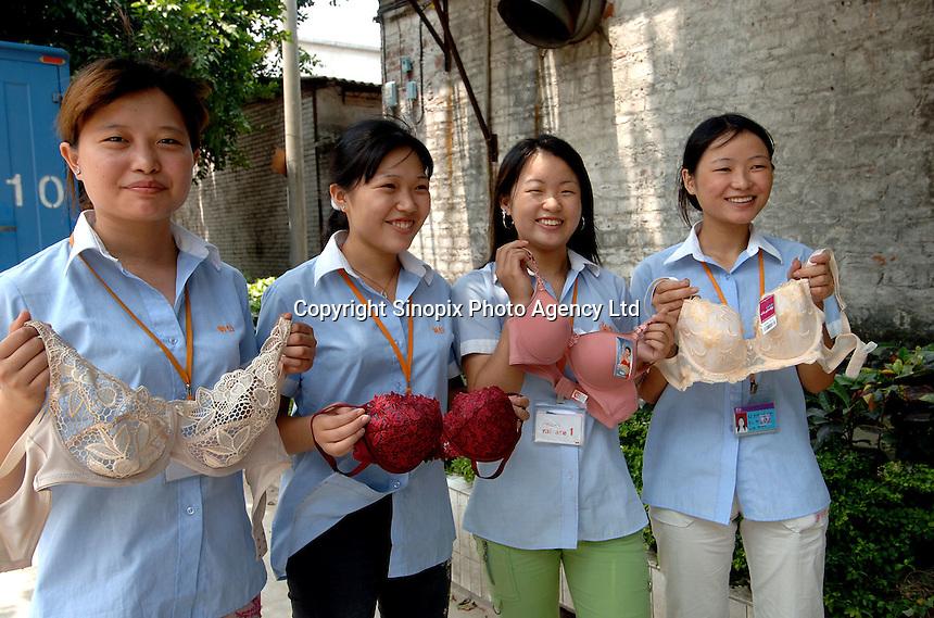 (Left to right) Chen Deng Qu, 19, Zhou Li Qin, 20, Huang Xiau Lan, 19, Hu Xiao Li, 17 outside the Kang Yi Underwear Company at the International Underwear City, Foshan City, Guangdong, China. ..PHOTO BY SINOPIX