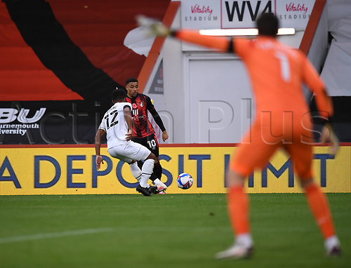31st October 2020; Vitality Stadium, Bournemouth, Dorset, England; English Football League Championship Football, Bournemouth Athletic versus Derby County; Nathan Byrne of Derby County challenges Arnaut Danjuma of Bournemouth for the ball