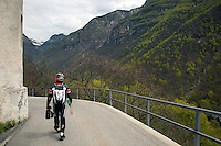 Switzerland. Canton Ticino. Corippo lies in the Verzasca valley. A german tourist, wearing a complete motorcycle suit with an helmet, is carrying PET and glass bottles to be thrown in the recycling garbage bin. Corippo is the smallest municipality in Switzerland. Despite this, it possesses the trappings of communities many times its size such as its own coat of arms and a town council consisting of three local citizens. A town council is a democratically elected form of government for small municipalities. A council may serve as both the representative and executive branch. The village has maintained its status as an independent entity since its incorporation in 1822. 8.05.13 © 2013 Didier Ruef?.