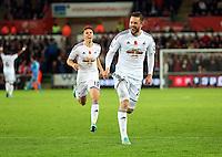Sunday 09 November 2014 <br /> An ecstatic Gylfi Sigurdsson of Swansea celebrating his equaliser<br /> Barclays Premier League, Swansea City FC v Arsenal City at the Liberty Stadium, Swansea, Great Britain.