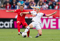 CARSON, CA - FEBRUARY 9: Jessie Fleming #17 of Canada and Julie Ertz #8 of the United States fight for the ball during a game between Canada and USWNT at Dignity Health Sports Park on February 9, 2020 in Carson, California.