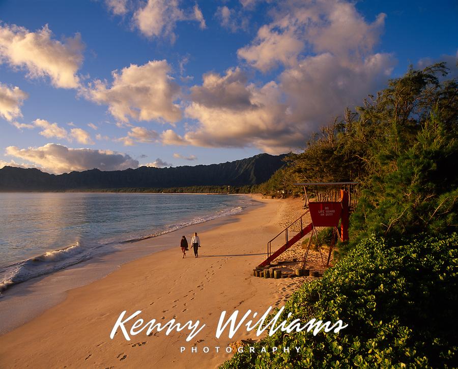 Lifeguard Tower & Two Women Walking on Beach, Bellows Beach, Oahu, Hawaii, USA.