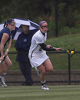 Boston College defender Kate Collins (6) brings the ball forward. Boston College defeated University of New Hampshire, 11-6, at Newton Campus Field, May 1, 2012.
