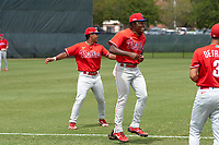 Philadelphia Phillies Jamari Baylor (right) and Marcus Lee Sang during warmups before an Extended Spring Training game against the New York Yankees on June 22, 2021 at the Carpenter Complex in Clearwater, Florida. (Mike Janes/Four Seam Images)