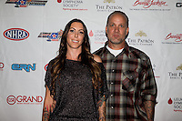 Aug. 29, 2013; Avon, IN, USA: NHRA NHRA funny car driver Alexis DeJoria (left) and husband Jesse James on the red carpet at the premiere of Snake & Mongoo$e at the Regal Shiloh Crossing Stadium 18. Mandatory Credit: Mark J. Rebilas-