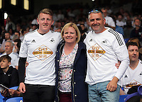 Pictured: Swansea supporters Cory, Amanda and Michael Gillam<br /> Re: Premier League match between Crystal Palace and Swansea City at Selhurst Park on Sunday 24 May 2015 in London, England, UK
