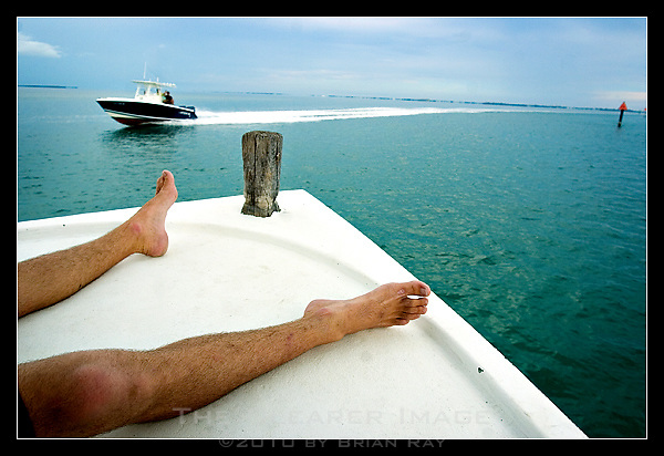 At the end of a long day on the water, Lawlor's favorite part of the job is relaxing on the bow of the boat as The Captain R & R makes its way back into port on Stock Island.