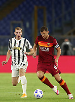 Football, Serie A: AS Roma - Juventus, Olympic stadium, Rome, September 27, 2020. <br /> Roma's captain Edin Dzeko (r) in action with Juventus' Delan Kulusevski (l) during the Italian Serie A football match between Roma and Juventus at Olympic stadium in Rome, on September 27, 2020. <br /> UPDATE IMAGES PRESS/Isabella Bonotto