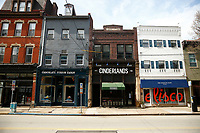 Businesses along Butler Street are shown along an empty road on Friday March 20, 2020 in the Lawrenceville neighborhood of Pittsburgh, Pennsylvania. (Photo by Jared Wickerham/Pittsburgh City Paper)