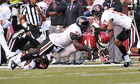 NWA Democrat-Gazette/MICHAEL WOODS • @NWAMICHAELW<br /> University of Arkansas running Alex Collins is tackled by Texas Tech defender Jah'Shawn Johnson in the 2nd quarter of Saturday nights game at Razorback Stadium in Fayetteville.