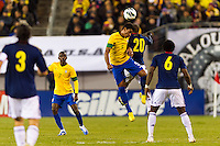 Paulinho (5) of Brazil and Macnelly Torres (20) of Colombia go up for a header. Brazil (BRA) and Colombia (COL) played to a 1-1 tie during international friendly at MetLife Stadium in East Rutherford, NJ, on November 14, 2012.