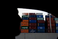 ELIZABETH, NEW JERSEY - MARCH 03: A driver crosses in front of containers at Port Elizabeth on March 03, 2021 in Elizabeth, New Jersey. According projections the EE.UU economy rises 5,5% in 2021. where the excess savings in North American households will return to the market after vaccination and boosting consumption. (Photo by VIEWpress)