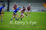 Dan Goggin of Causeway on a run as St Brendans Padraig O'Sullivan gives chase in the County Senior Hurling championship