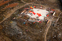A demolished house with flags around it in Linzhou. /Felix Features