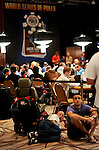 Spectators at the WSOP sit on the floor and watch the seminfinal World Cup game between Germany and Spain.