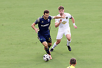 CARY, NC - AUGUST 01: Steven Miller #31 is challenged for the ball by Jonathan Dean #24 during a game between Birmingham Legion FC and North Carolina FC at Sahlen's Stadium at WakeMed Soccer Park on August 01, 2020 in Cary, North Carolina.