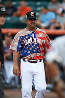 Aberdeen Ironbirds manager Luis Pujols (55) during the lineup exchange before a game against the Tri-City ValleyCats on August 6, 2015 at Ripken Stadium in Aberdeen, Maryland.  Tri-City defeated Aberdeen 5-0 in a combined no-hitter.  (Mike Janes/Four Seam Images)