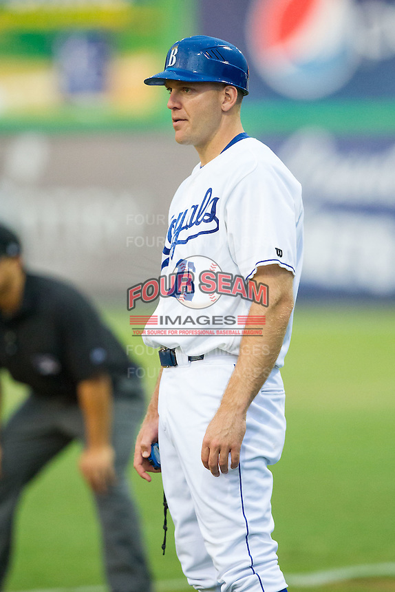 Burlington Royals coach Scott Thorman (16) coaches first base during the game against the Princeton Rays at Burlington Athletic Park on July 9, 2014 in Burlington, North Carolina.  The Rays defeated the Royals 3-0.  (Brian Westerholt/Four Seam Images)