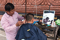 Street Barber in Phnom Penh, Cambodia