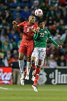 Bridgeview, IL, USA - Tuesday, October 11, 2016: Panama forward Rolando Blackburn (9) and Mexico midfielder Orbelin Pineda (22) compete for a headed ball during an international friendly soccer match between Mexico and Panama at Toyota Park. Mexico won 1-0.