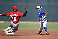 Kansas City Royals shortstop Ricky Aracena (2) turns a double play as Cory Thompson (15) slides in during an Instructional League game against the Cincinnati Reds on October 14, 2014 at Goodyear Training Facility in Goodyear, Arizona.  (Mike Janes/Four Seam Images)