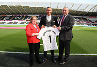 Lee Trundle with match sponsor during the Premier League match between Swansea City and Watford at The Liberty Stadium, Swansea, Wales, UK. Saturday 23 September 2017