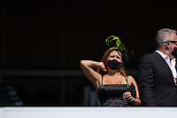 5th September 202, Louisville, KY, USA; A spectator wears a derby hat and mask during the 146th Kentucky Derby on September 5, 2020 at Churchill Downs in Louisville, KY.