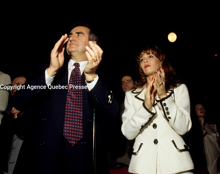 """Montreal (Qc) CANADA - File Photo - Jan 1996 -<br /> Lucien Bouchard,  Leader Parti Quebecois (from Jan 29, 1996 to March 2, 2001). seen in a file photo with wife Audrey Best.<br /> <br /> After the Yes side lost the 1995 referendum, Parizeau resigned as Quebec premier. Bouchard resigned his seat in Parliament in 1996, and became the leader of the Parti QuÈbÈcois and premier of Quebec.<br /> <br /> On the matter of sovereignty, while in office, he stated that no new referendum would be held, at least for the time being. A main concern of the Bouchard government, considered part of the necessary conditions gagnantes (""""winning conditions"""" for the feasibility of a new referendum on sovereignty), was economic recovery through the achievement of """"zero deficit"""". Long-term Keynesian policies resulting from the """"Quebec model"""", developed by both PQ governments in the past and the previous Liberal government had left a substantial deficit in the provincial budget.<br /> <br /> Bouchard retired from politics in 2001, and was replaced as Quebec premier by Bernard Landry."""