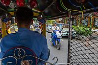 Bangkok, Thailand.  Passenger's Street View from inside a Tuk-Tuk (Three-wheeled motorcycle taxi.)