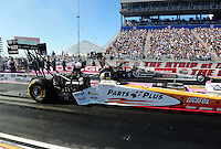 Oct. 29, 2011; Las Vegas, NV, USA: NHRA top fuel dragster driver Clay Millican (near lane) races alongside Rod Fuller during qualifying for the Big O Tires Nationals at The Strip at Las Vegas Motor Speedway. Mandatory Credit: Mark J. Rebilas-