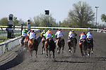 Stately Victor with Alan Garcia (yellow silks) thunders to the outside to win The Toyota Bluegrass Stakes. 04.10.2010