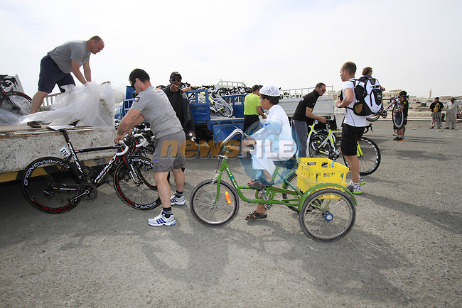 Local boy watches as team mechanics offload their bikes before the start of Stage 4 of the 2012 Tour of Qatar from Al Thakhira to Madinat Al Shamal, Qatar. 8th February 2012.<br /> (Photo Eoin Clarke/Newsfile)