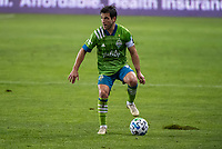 SAN JOSE, CA - OCTOBER 18: Nicolas Lodeiro #10 of the Seattle Sounders dribbles the ball during a game between Seattle Sounders FC and San Jose Earthquakes at Earthquakes Stadium on October 18, 2020 in San Jose, California.