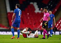 Referee Jesús Gil Manzano of Spain shows Harry Maguire (Manchester United) of England a second yellow card and then a red for a foul on Kasper Dolberg (Nice) of Denmark during the UEFA Nations League match played behind closed doors due to the current government Covid-19 rules within sports venues between England and Denmark at Wembley Stadium, London, England on 14 October 2020. Photo by Andy Rowland.