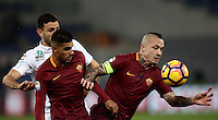 Calcio, Serie A: Roma vs ChievoVerona. Roma, stadio Olimpico, 22 settembre 2016.<br /> Chievo Verona's Ivan Radovanovic, left, fights for the ball against Roma's Emerson Palmieri, center, and Radja Nainggolan, during the Italian Serie A football match between Roma and Chievo Verona, at Rome's Olympic stadium, 22 December 2016.<br /> UPDATE IMAGES PRESS/Isabella Bonotto