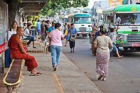 Myanmar, Burma.  Yangon, Bus Stop on Sule Pagoda Road.