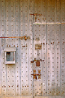 An old door with rusty locks and bolts at the medieval Chateau de Rully in Cote Chalonnaise, Bourgogne.