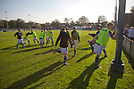 Lancaster City 0 FC Halifax Town 3, 15/10/2011, Giant Axe, FA Cup Third Qualifying Round. Home team players going through their warm-up routine at Lancaster City's Giant Axe ground prior to the club's FA Cup third qualifying round match against FC Halifax Town. The visitors, who play two leagues above their hosts in the English football pyramid, won the ties by three goals to nil, watched by a crowd of 646 spectators. Lancaster City were celebrating their centenary in 2011, although there was a dispute over the exact founding date over the club known as Dolly Blue. Photo by Colin McPherson.