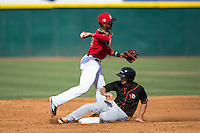 Hickory Crawdads shortstop Yeyson Yrizarri (2) turns a double play as Austin Anderson (14) of the Delmarva Shorebirds slides into second base at L.P. Frans Stadium on June 18, 2016 in Hickory, North Carolina.  The Crawdads defeated the Shorebirds 1-0 in game one of a double-header.  (Brian Westerholt/Four Seam Images)