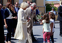 Pictured: Prince Charles and wife the Duchess of Cornwall are given flowers by local children at the village of Arhanes on the island of Crete, Greece. Friday 11 May 2018 <br /> Re: HRH Prnce Charles and his wife the Duchess of Cornwall visit thevillage of Arhanes near Heraklion, Greece.