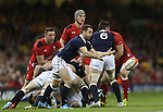 Scotland scrum half Greig Laidlaw whips the ball away from the breakdown.<br /> RBS 6 Nations 2014<br /> Wales v Scotland<br /> Millennium Stadium<br /> <br /> 15.03.14<br /> <br /> ©Steve Pope-SPORTINGWALES