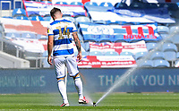 Ryan Manning of Queens Park Rangers  cleans his boots with the water sprinkler during Queens Park Rangers vs Millwall, Sky Bet EFL Championship Football at Loftus Road Stadium on 18th July 2020