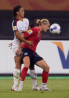 Shannon Boxx, Kelly Smith. The USA defeated England, 3-0 during the quarterfinals of the FIFA Women's World Cup in Tianjin, China.  The USA defeated England, 3-0.