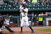 Shortstop Maikel Garcia (8) of the Columbia Fireflies in a game against the Charleston RiverDogs on Tuesday, May 11, 2021, at Segra Park in Columbia, South Carolina. The catcher is Jonathan Embry (1). (Tom Priddy/Four Seam Images)