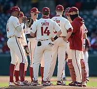 Arkansas pitching coach Matt Hobbs speaks Wednesday, April 7, 2021, to starter Caleb Bolden during the fourth inning of the Razorbacks' 10-3 win over UALR at Baum-Walker Stadium in Fayetteville. Visit nwaonline.com/210408Daily/ for today's photo gallery. <br /> (NWA Democrat-Gazette/Andy Shupe)