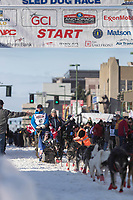 Aaron Peck and team leave the ceremonial start line with an Iditarider at 4th Avenue and D street in downtown Anchorage, Alaska on Saturday March 2nd during the 2019 Iditarod race. Photo by Brendan Smith/SchultzPhoto.com