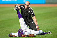 Winston-Salem Dash strength coach Adam Tischler helps a player stretch prior to the game against the Wilmington Blue Rocks at BB&T Ballpark on April 23, 2011 in Winston-Salem, North Carolina.   Photo by Brian Westerholt / Four Seam Images