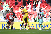 David Raya of Brentford celebrates at full time as André Ayew of Swansea City looks dejected during the Sky Bet Championship Play Off Final match between Brentford and Swansea City at Wembley Stadium in London, England, UK. Saturday 29 May 2021