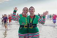 Pictured: Two young women in elf costumes. Wednesday 25 December 2019<br /> Re: Hundreds of people in fancy dress, have taken part in this year's Porthcawl Christmas Swim in south Wales, UK.